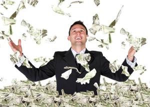 Успешный бизнесмен с деньгами